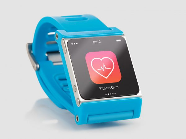 Close up blue smart watch with fitness app icon on the screen