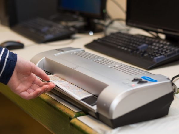 Person in laminating a pictorial expression