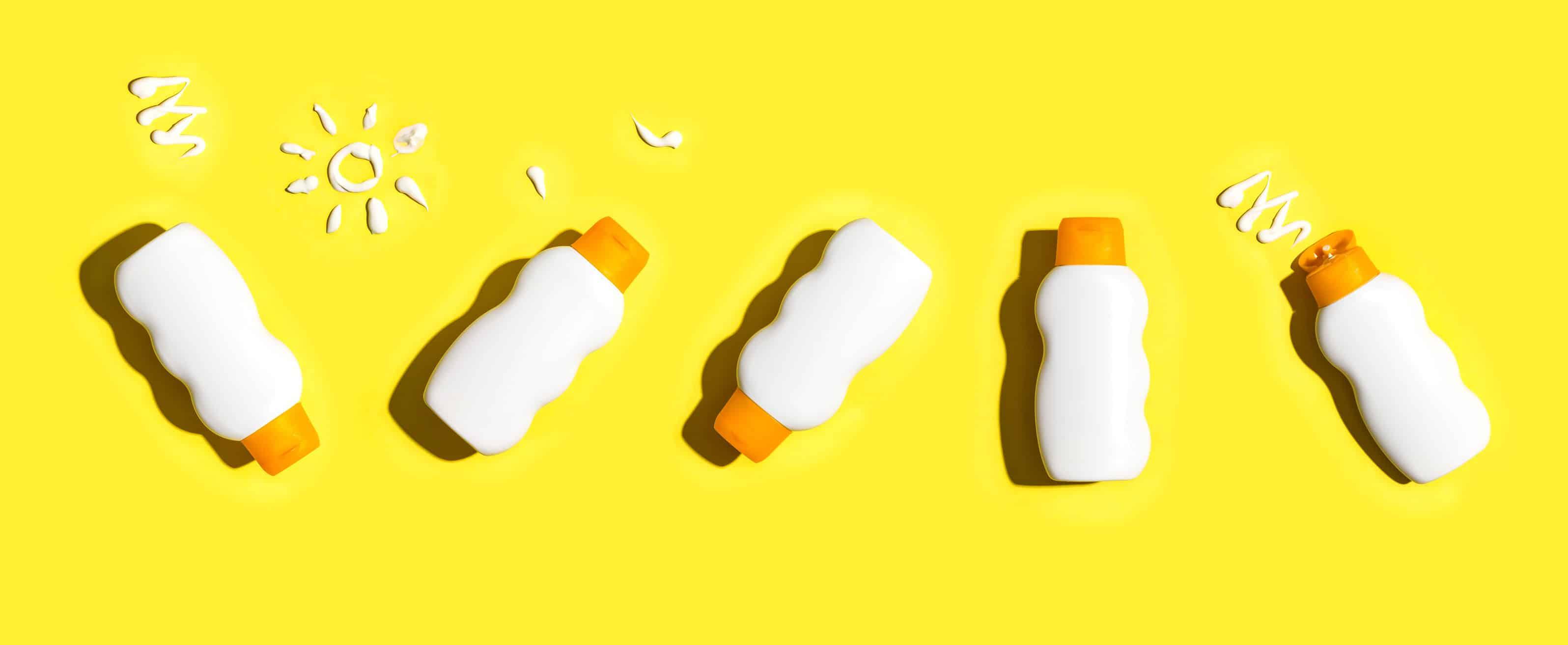 Imagem de dois potes de protetor solar.
