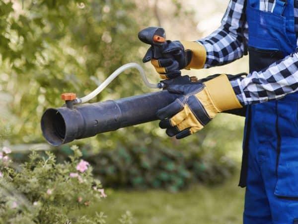 Gardener using modern gardening equipment