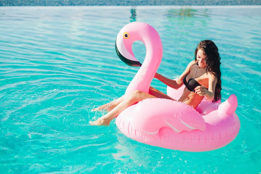 woman in big pink float