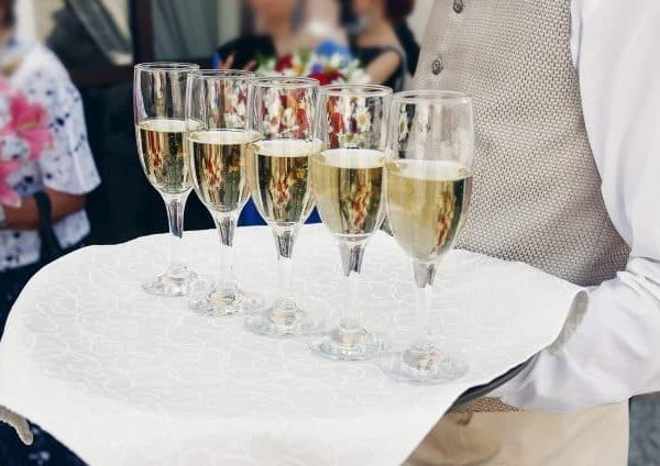 person with glasses of champagne