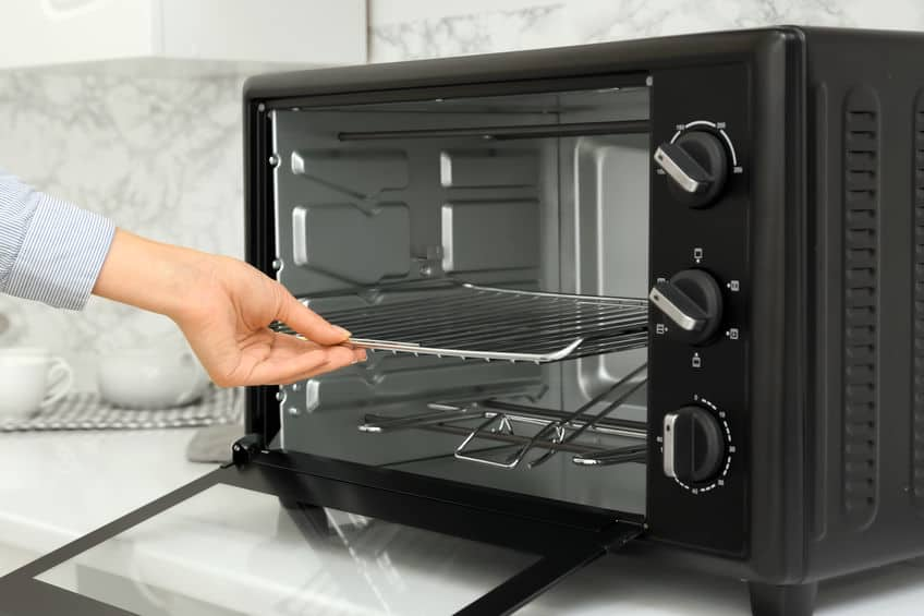 person lighting oven