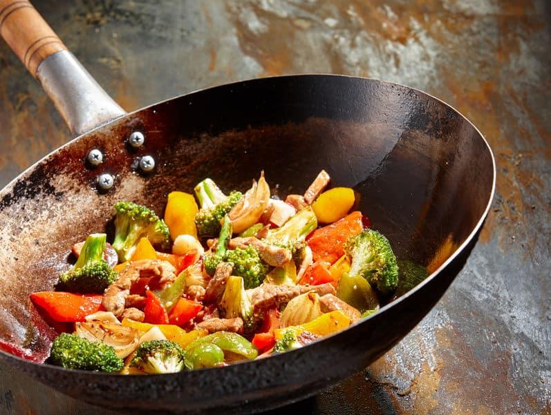 cooking vegetables in panela wok