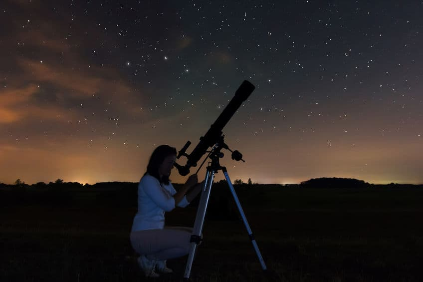 woman watching in the telescope