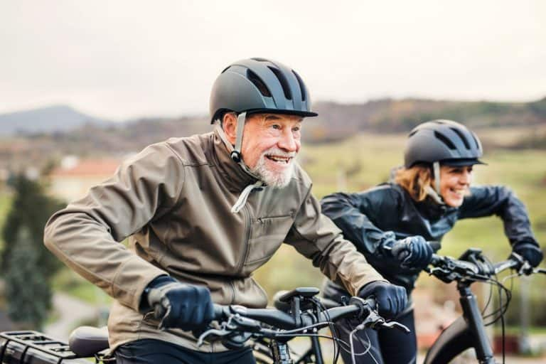 elder couple riding bikes