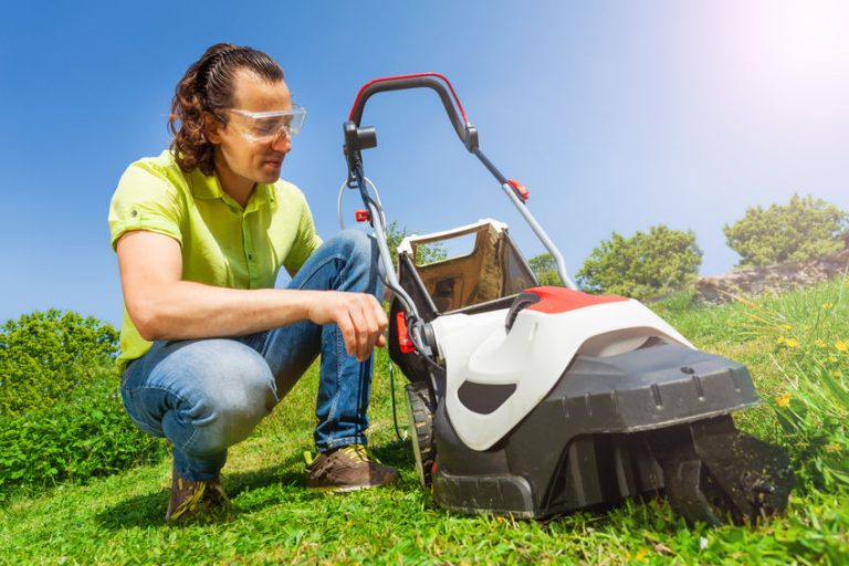 man using a mower
