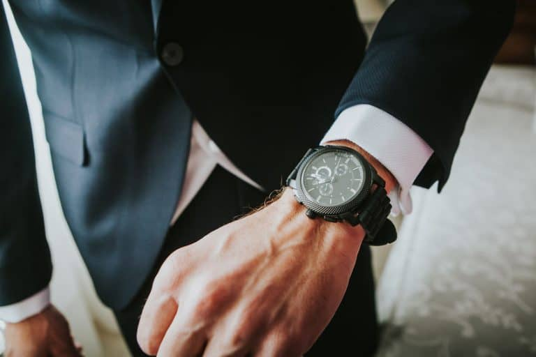 business man wearing a conventional watch