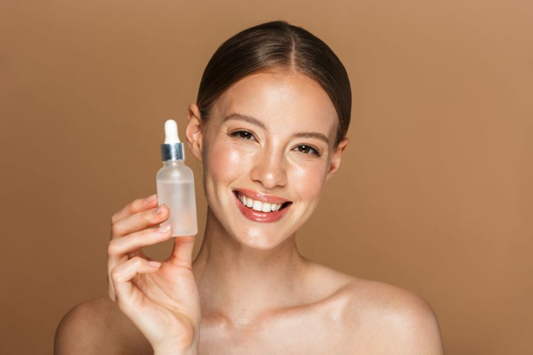 woman with a little container of serum