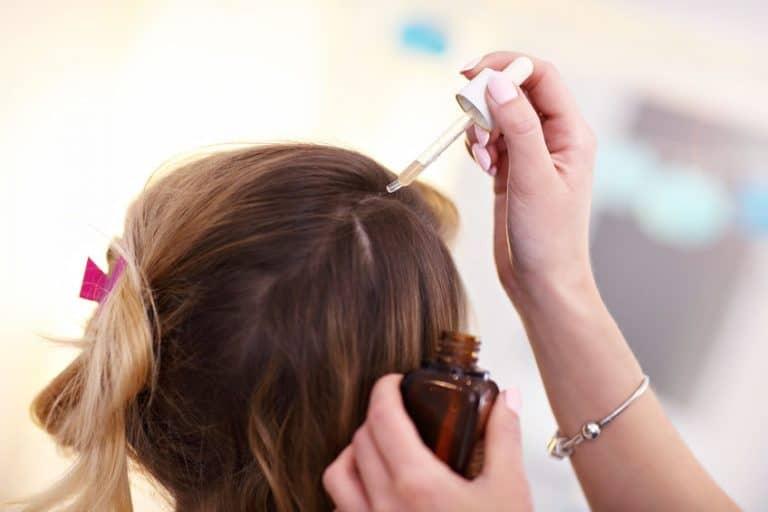 applying oil in hair
