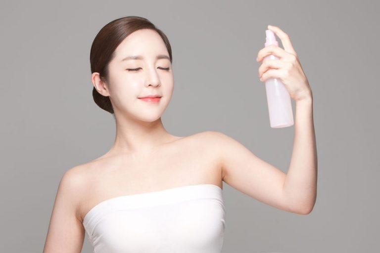 girl applying a spray