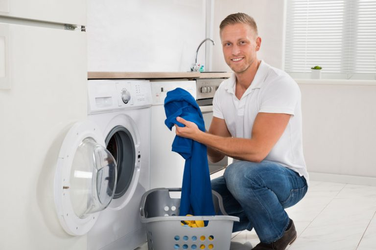 man doing washing his clothes