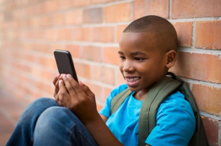 little boy using a phone