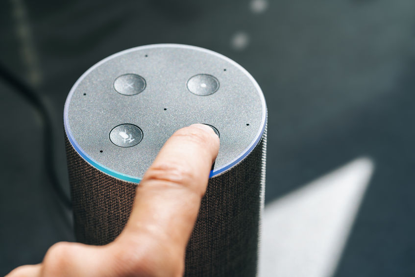 finger touching voice controlled smart speaker