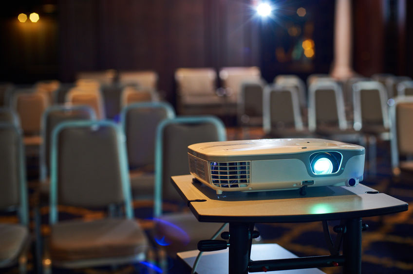 Working projector at the conference hall