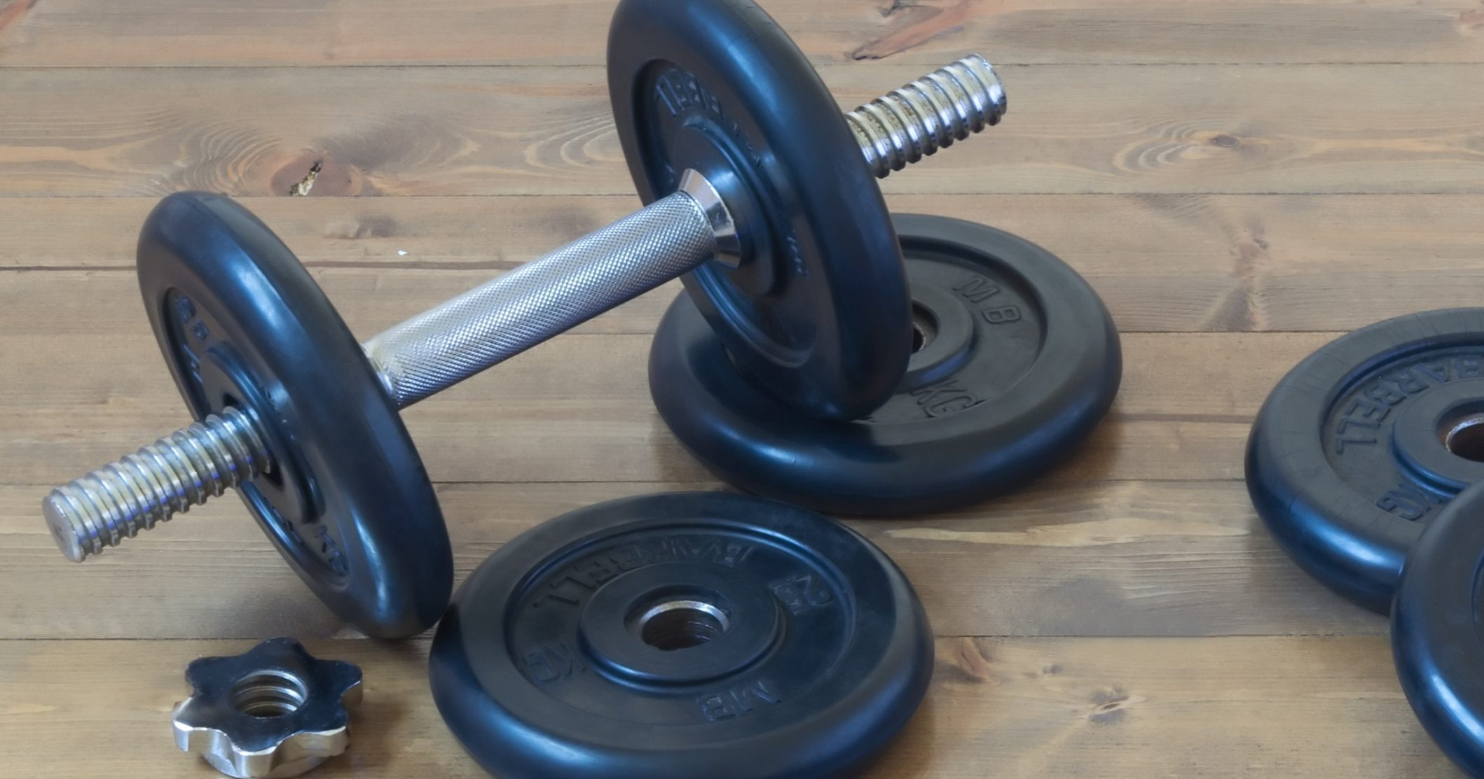 dumbbells with a blue towel sports