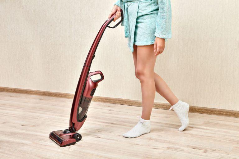 girl vacuuming the floor