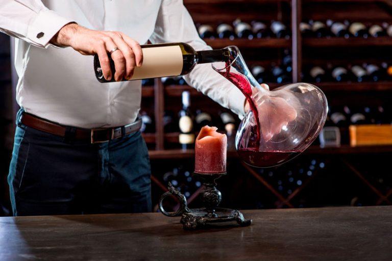 bartender serving some wine