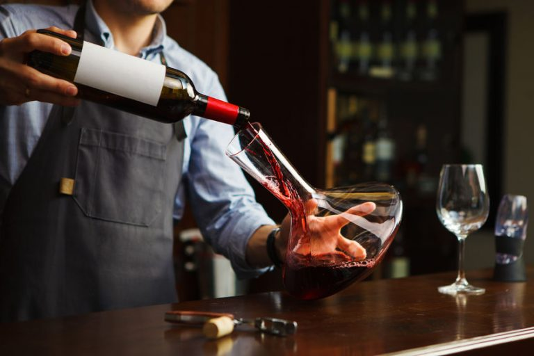 Bartender serving a wine cup