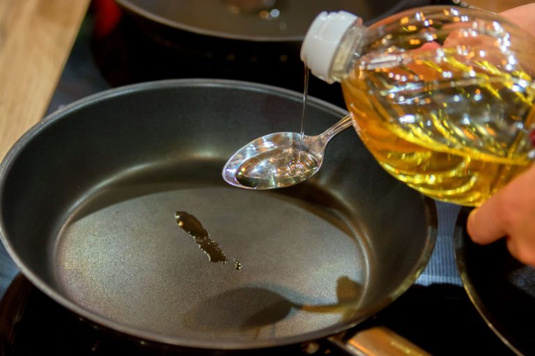 serving some oil on a pan
