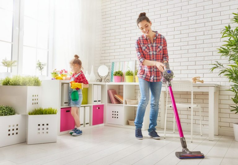 mother and daughter creaning a room