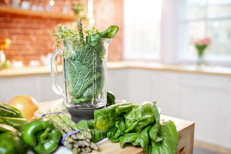 blender and green vegetables