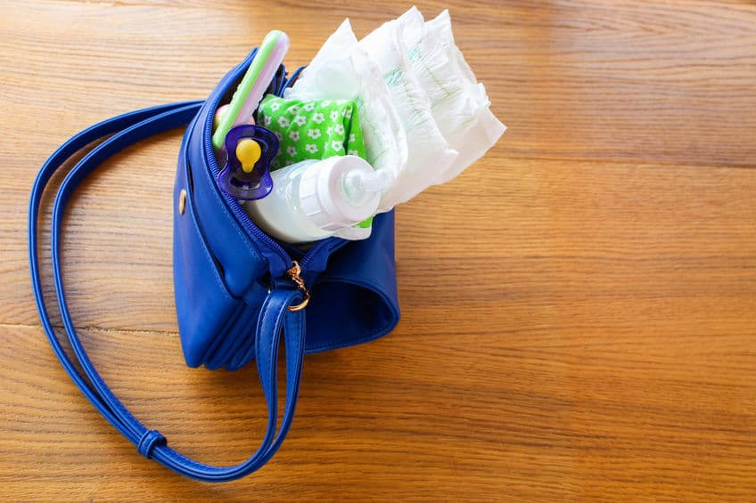 baby bag with diapers and feeding bottle