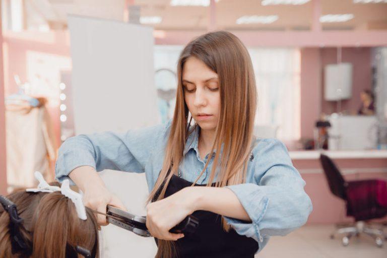 stylish girl ironing hair