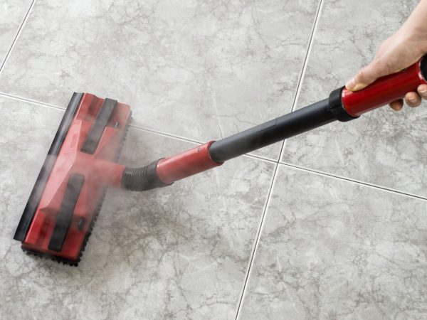 cleaning a carpet with steam