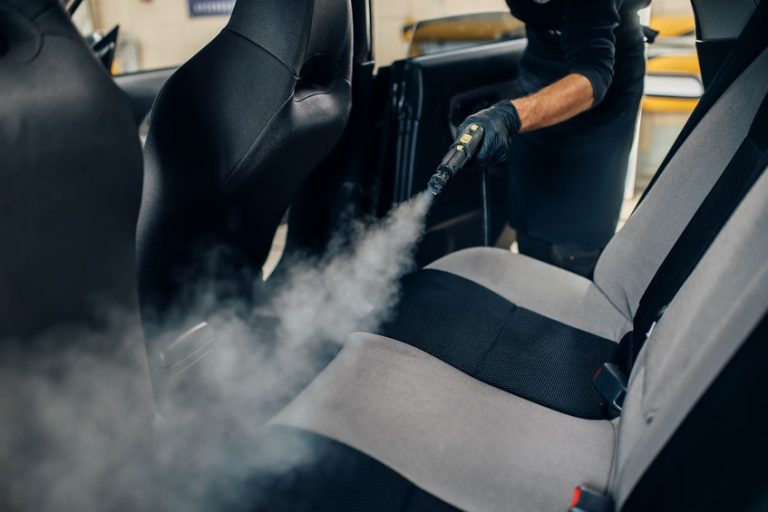 cleaning a car with steam