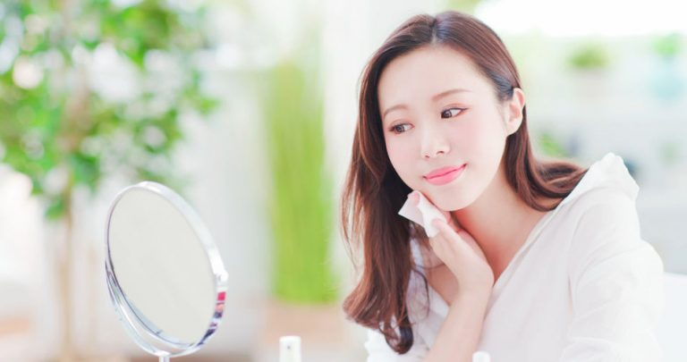 girl cleaning her face