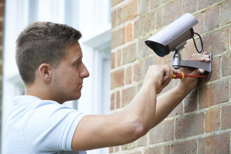 electrician guy installing a security camera