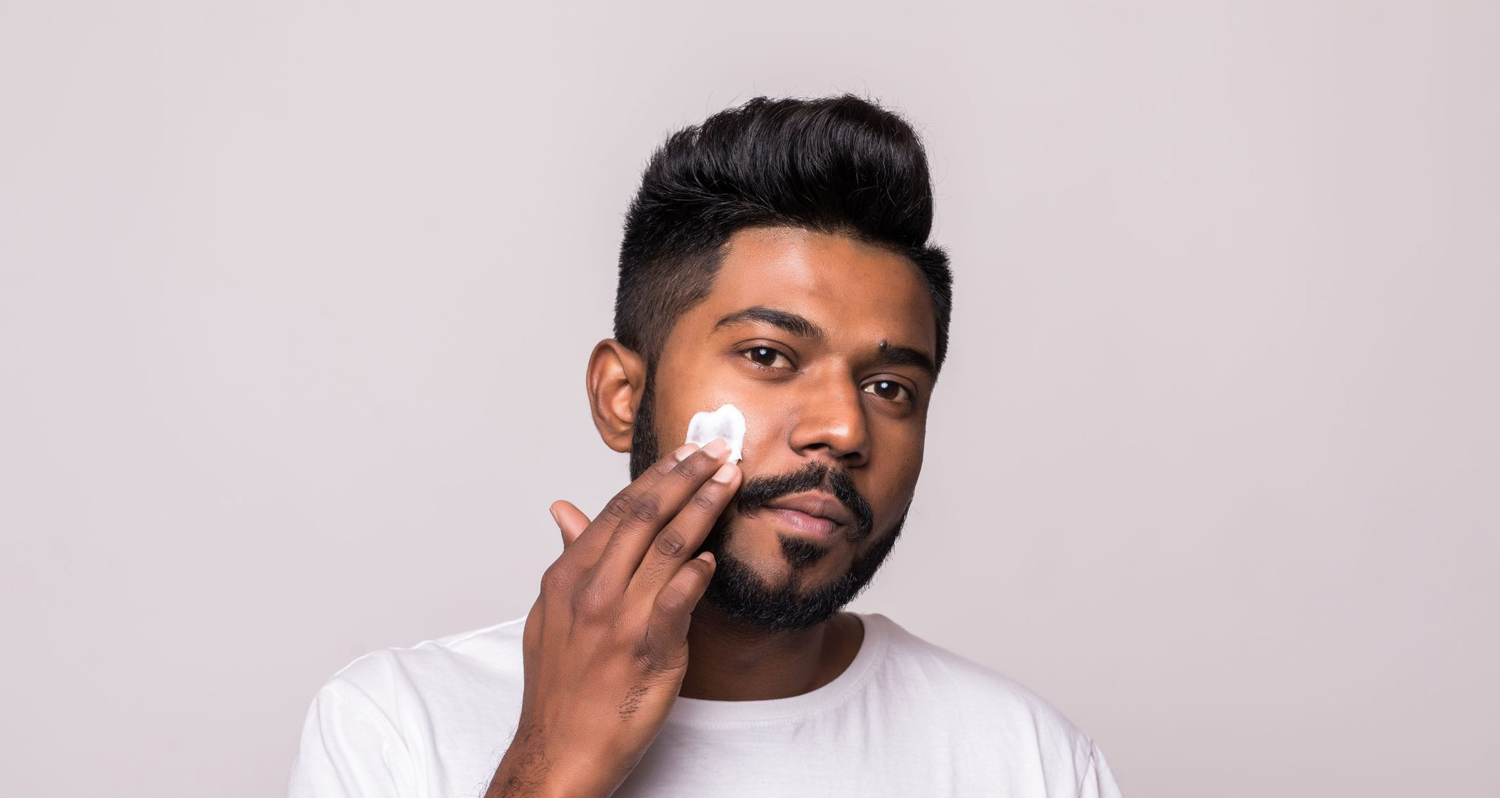 man using shaving cream