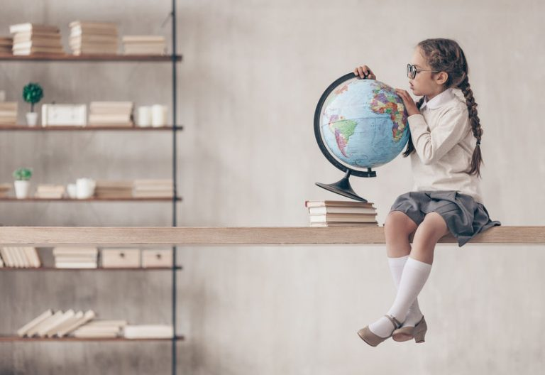 Girl with a terraqueous globe