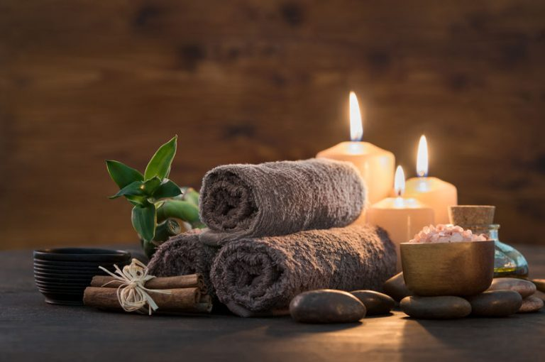 brown towels and some candles