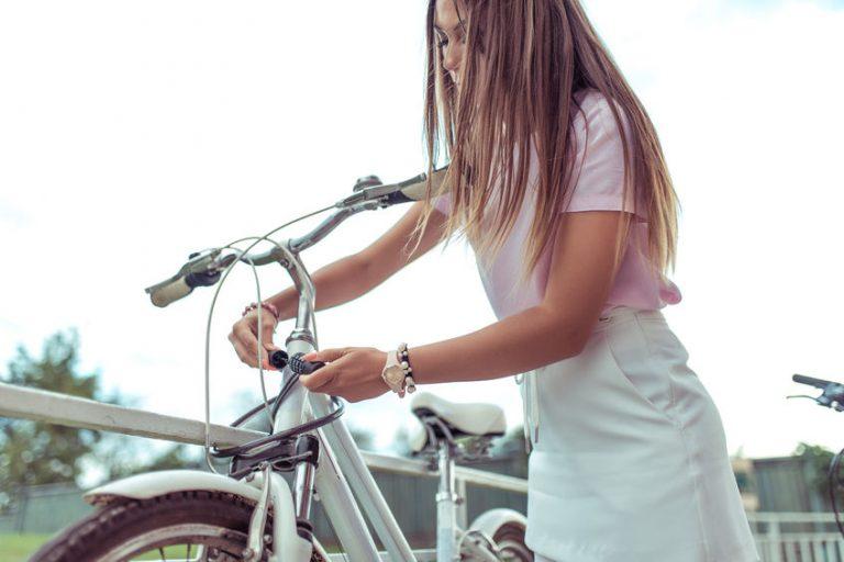 girl locking her bicycle