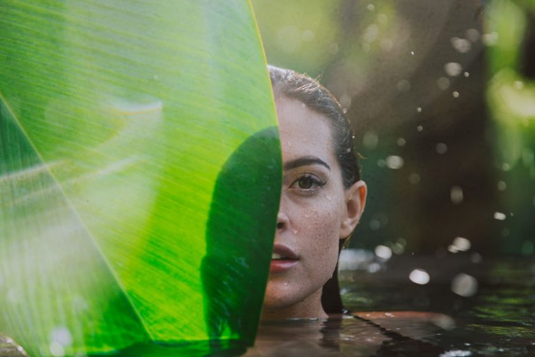 girl swimming in forest