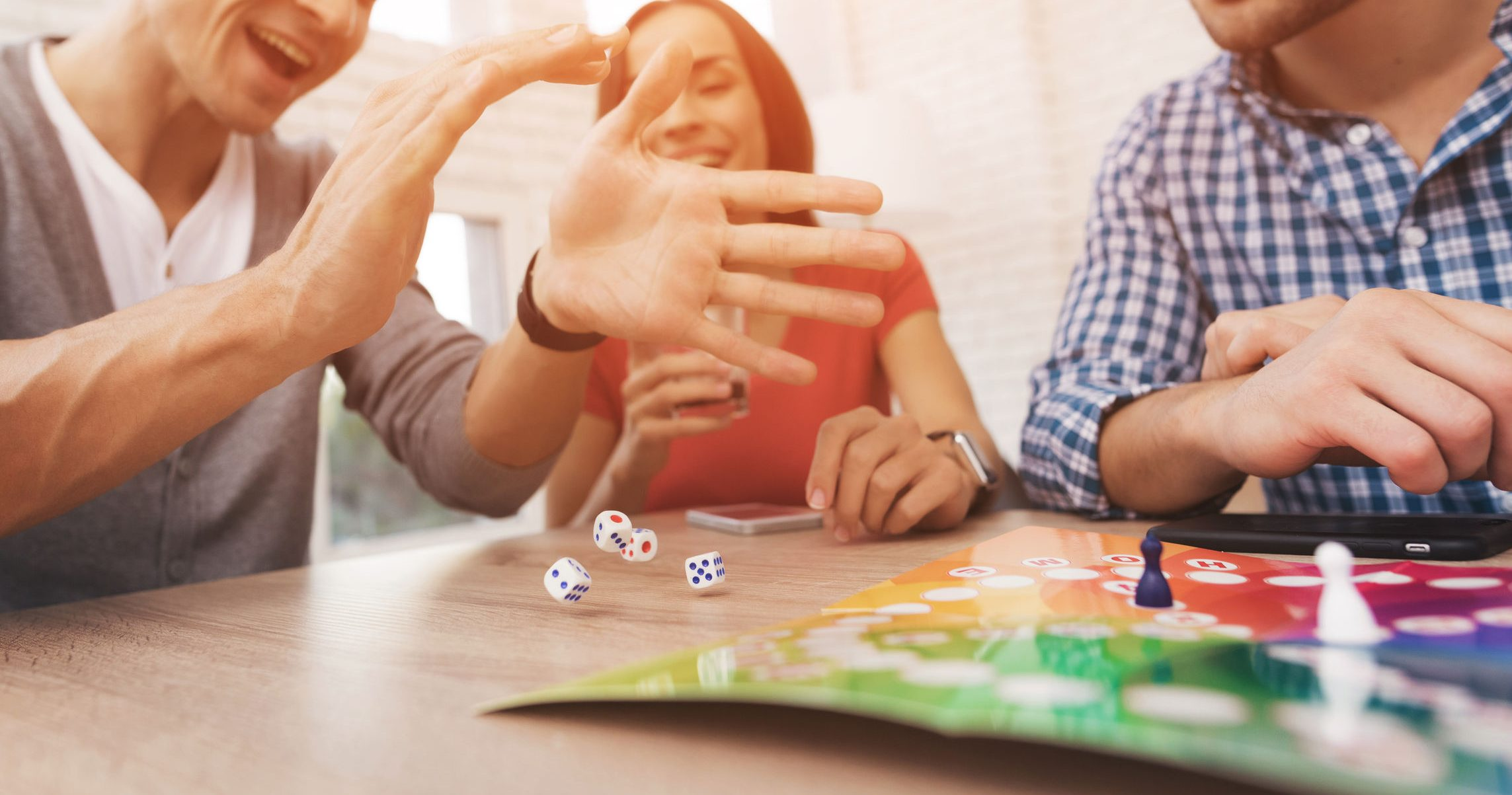 adults playing board games