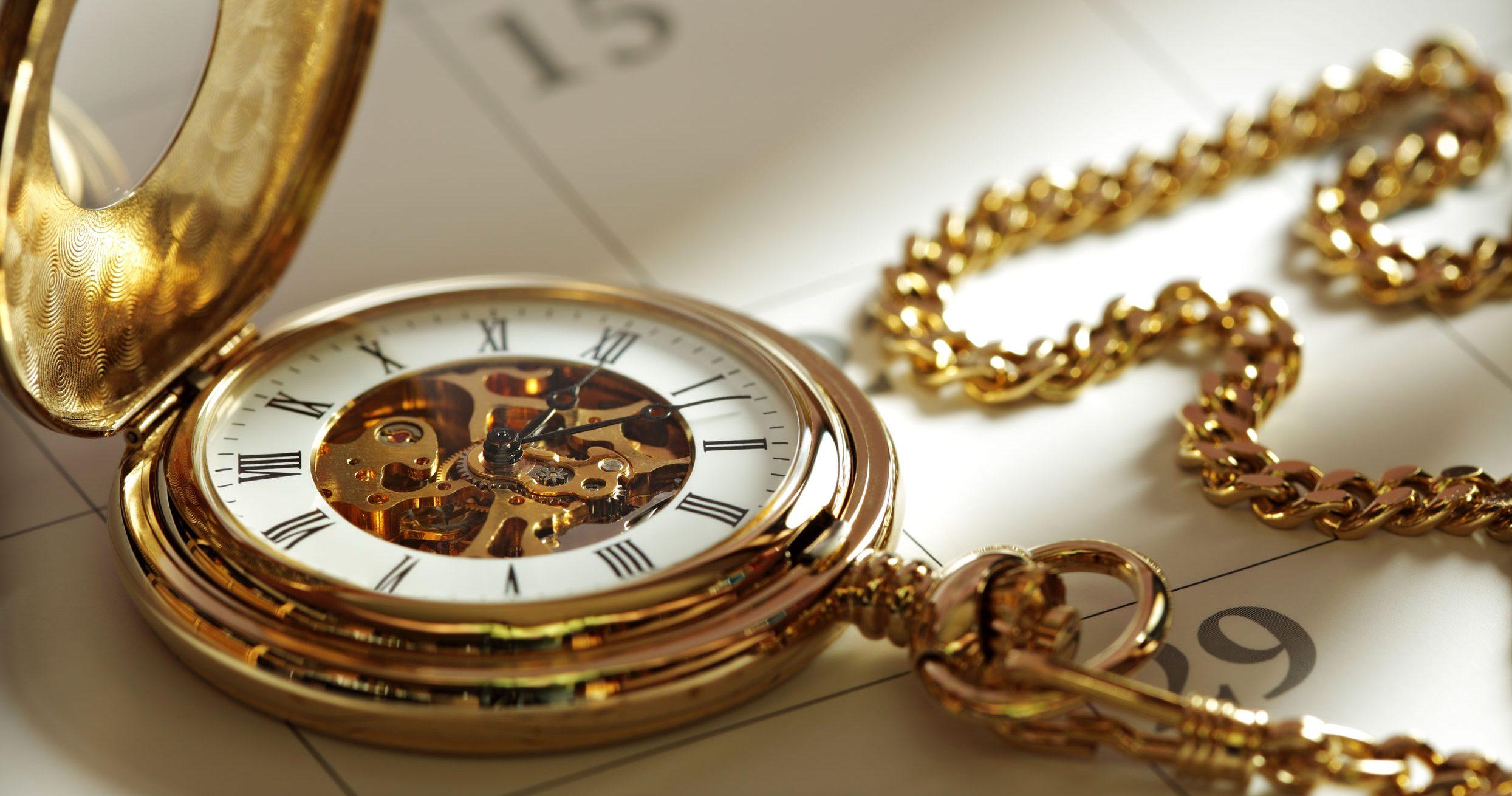 golden watch on a calendar
