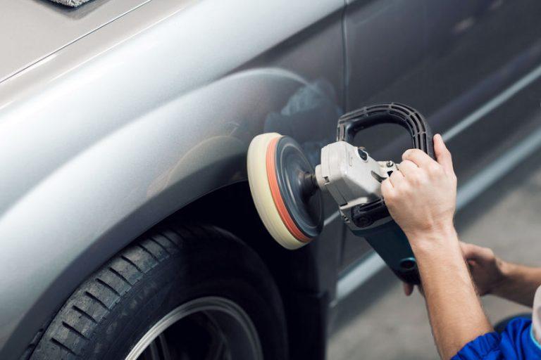 polishing a gray car