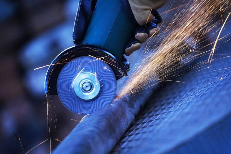 grinding a steel bar