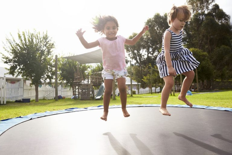 little girls on a trampoline