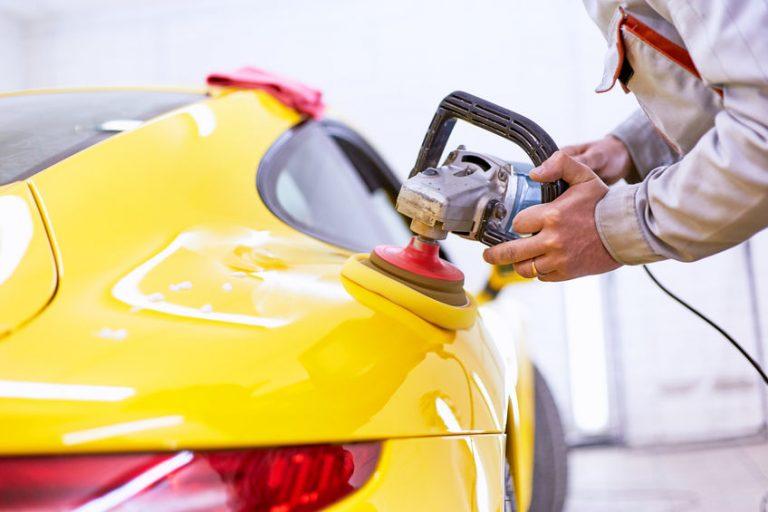polishing a yellow car