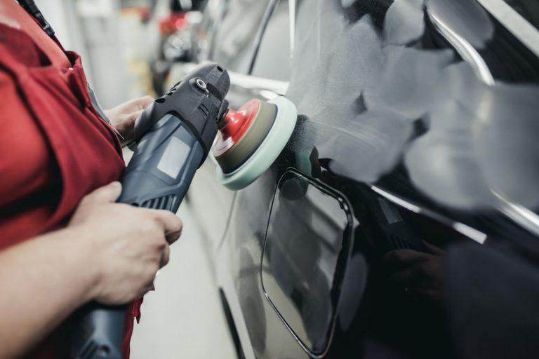 polishing a grey car