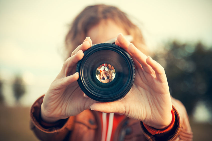 girl with a camera lens
