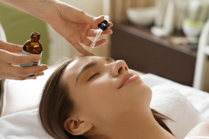 Face Skin Care. Woman Receiving Serum Treatment In Beauty Salon