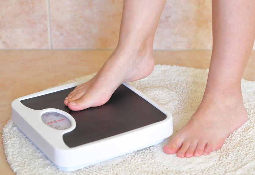 anotando o peso corporal